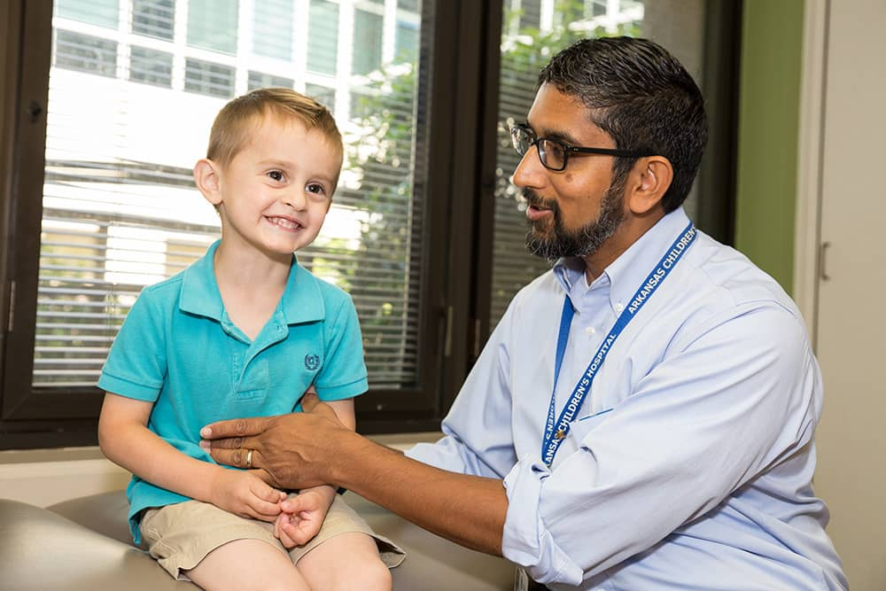 Smiling boy with urology doctor